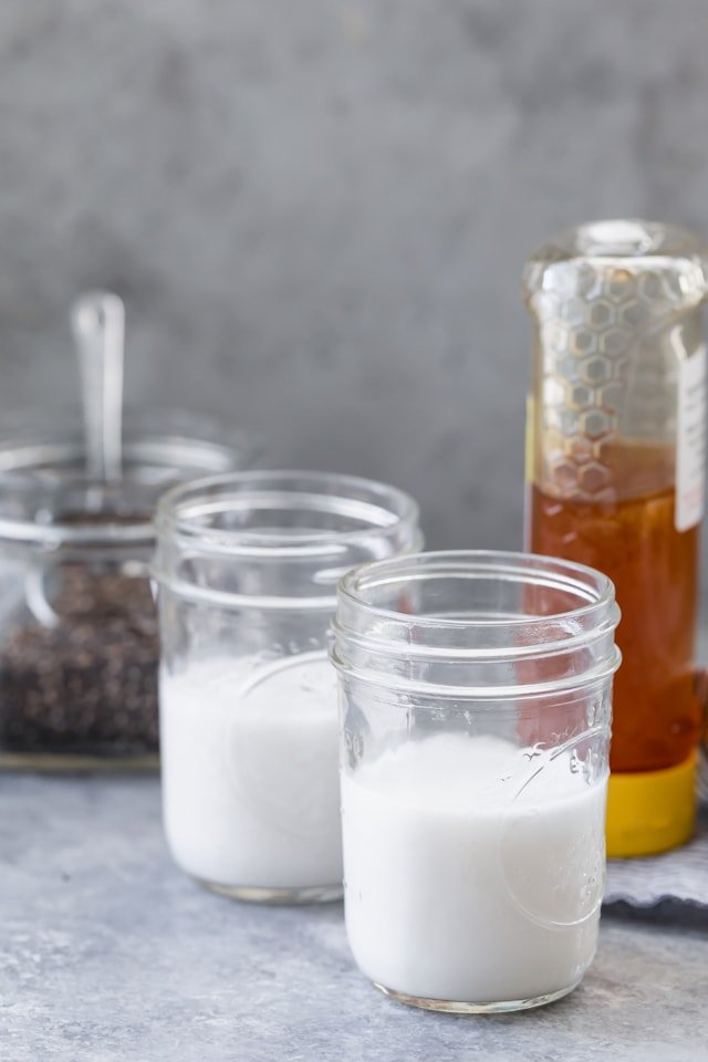 Ingredients to make 3-Ingredient Chia Pudding - almond milk, chia seeds and honey