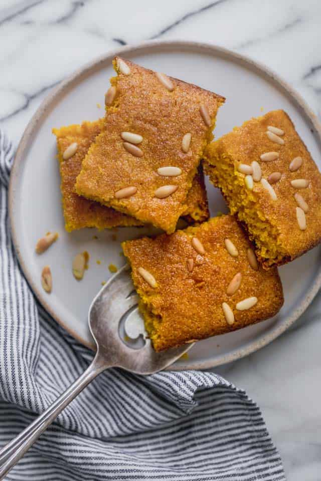 Semolina Turmeric Cake. Sfouf is a Middle Eastern semolina turmeric cake, made with simple ingredients, no eggs and no butter. It's vegan-friendly, light and simply delightful! | Vegan Cake | Vegan Dessert | Turmeric Recipes | Dairy Free Recipe | #cake #vegan #dairyfree #turmeric #feelgoodfoodie