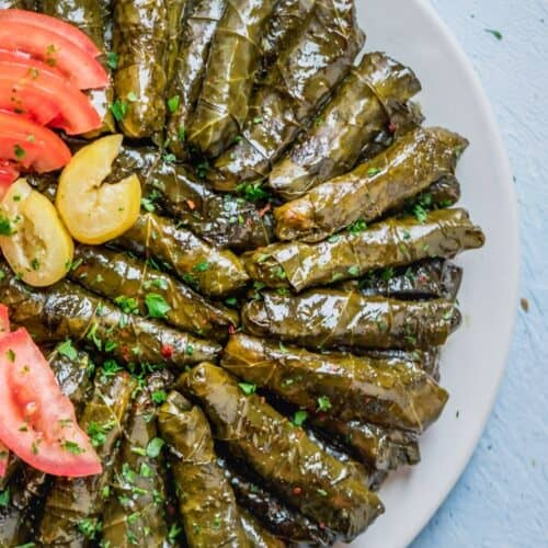 Large plate of rolled vegetarian stuffed grape leaves