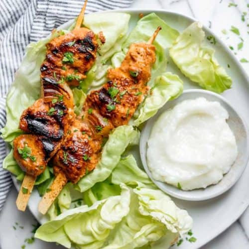 Shish Tawook is a popular Lebanese grilled chicken skewers recipe. It's tender juicy chicken marinated in yogurt, lemon & garlic and served with pita bread