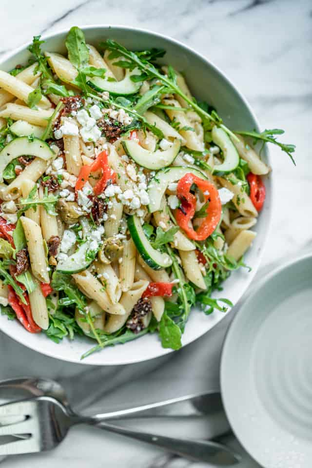 This healthy Mediterranean Pasta Salad is a summertime favorite recipe. It's quick and easy to make, loaded with veges & tossed in a red wine vinaigrette!