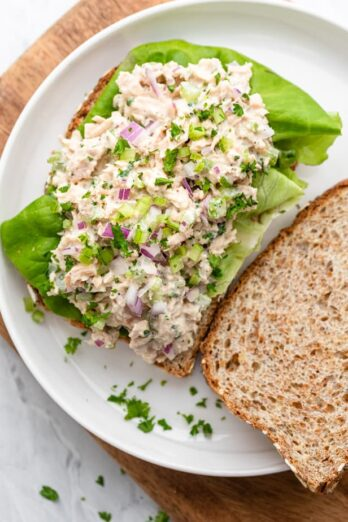 Tuna salad on a slice of bread with lettuce