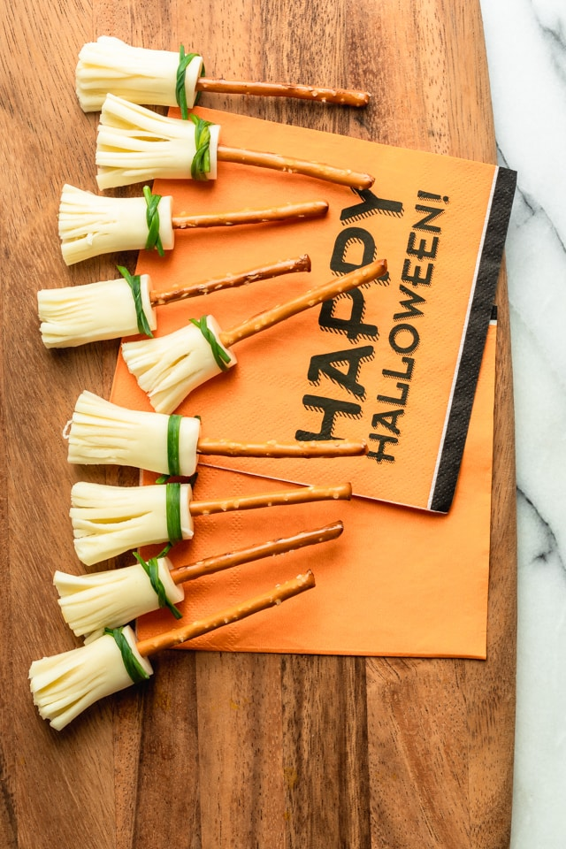 Witches Brooms snacks next to Halloween decor