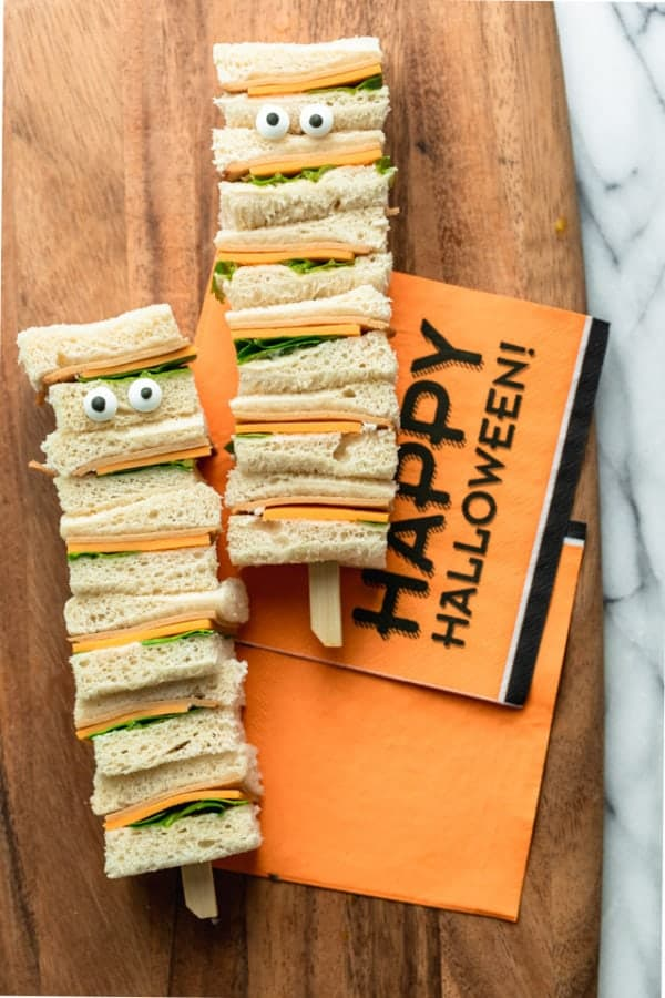 Easy Halloween Snacks #3: Assembled Mummy Kabobs ingredients: bread, cheese, turkey, lettuce, mayonnaise and two sets of candy eyes