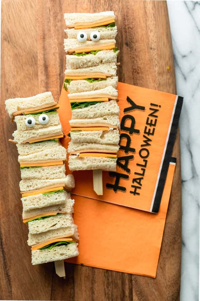 Halloween Snack 3: Assembled Mummy Kabobs ingredients: bread, cheese, turkey, lettuce, mayonnaise and two sets of candy eyes