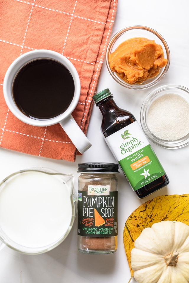 Ingredients to make pumpkin spice latte - coffee, milk, pumpkin spice, sugar, pumpkin puree and vanilla extract