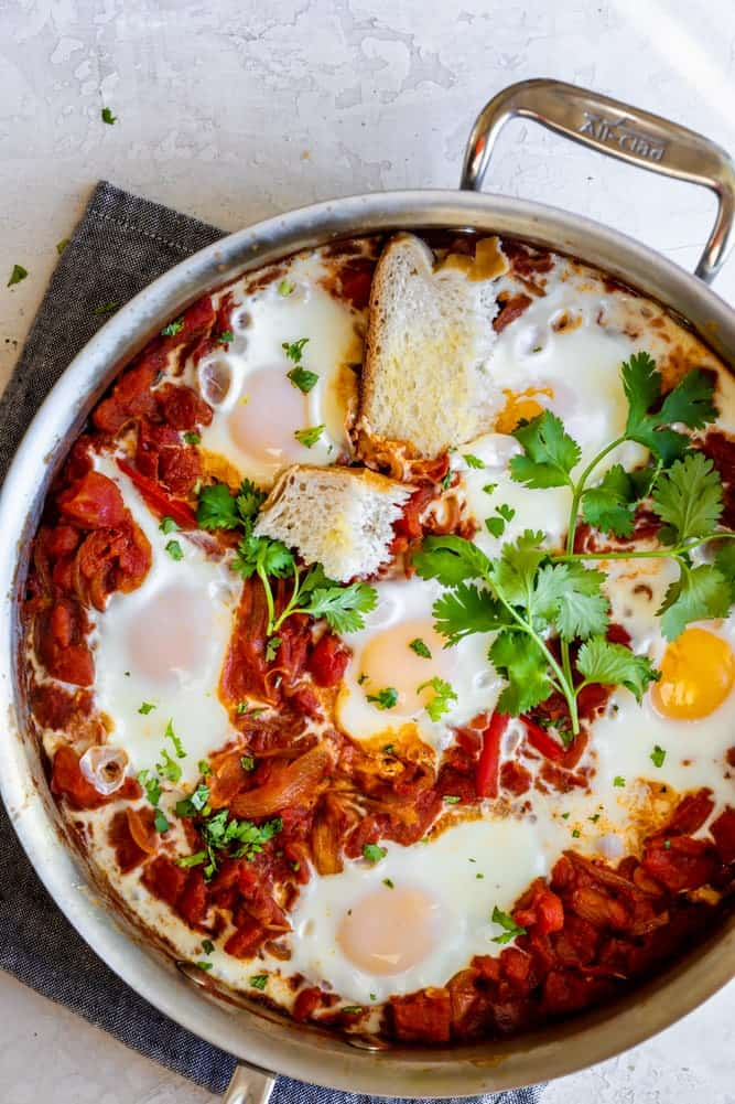Final poached eggs Shakshuka Recipe in a stainless steel pan