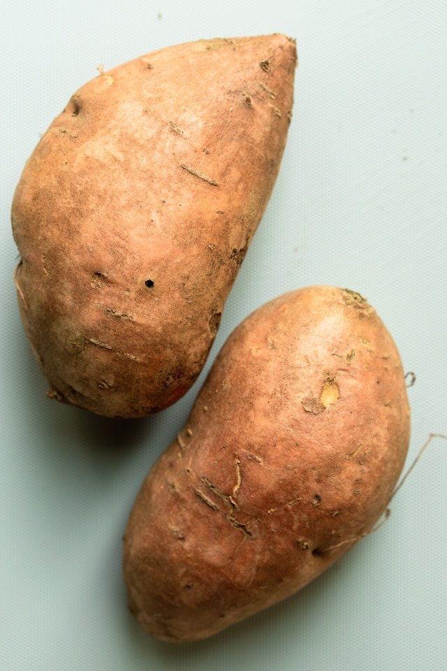 Two large sweet potatoes to show the thickness and size of preferred sweet potatoes to use