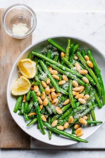 Large plate of green beans with almonds - Thanksgiving side dish