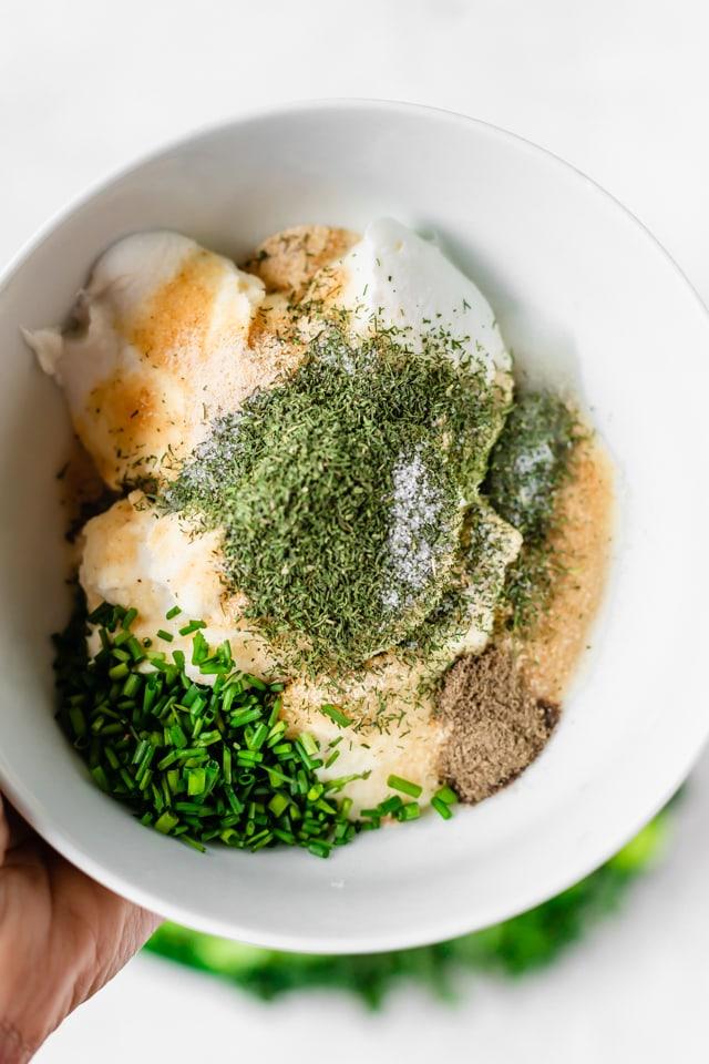 Bowl of ingredients to make ranch dip for crudite platter