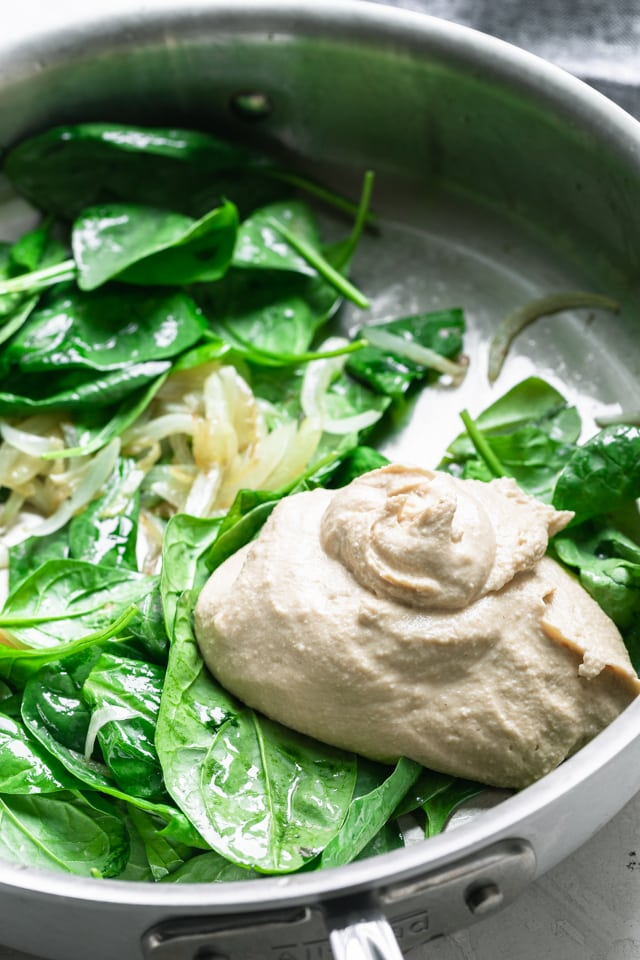 Hummus added to the spinach, garlic and onions mixture