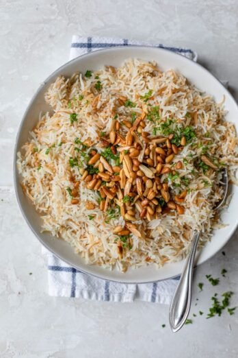 Plate served of Lebanese Rice topped with pine nuts, almonds and parsley