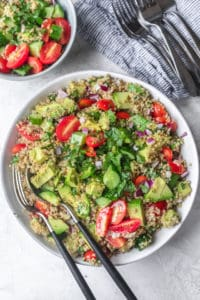Final plated large bowl of quinoa avocado salad