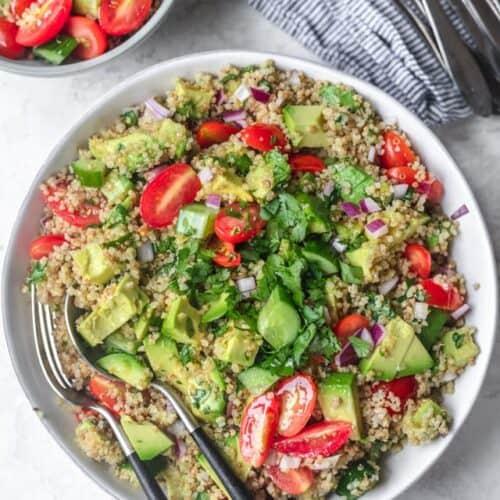 Final plated large bowl of quinoa avocado salad