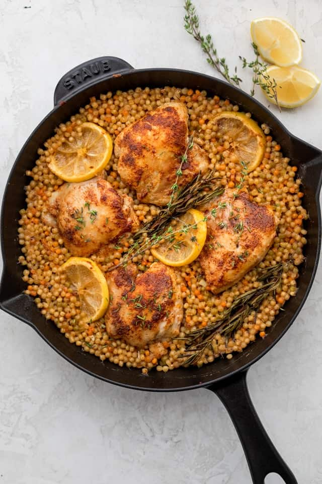 Final outcome of the skillet chicken with couscous shown in the cast iron skillet
