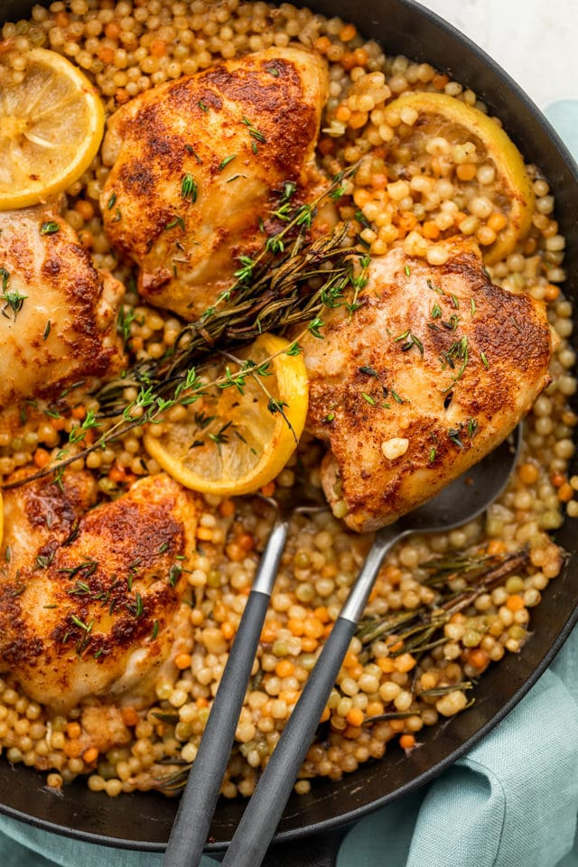 Skillet chicken with couscous in a large back cast iron skillet