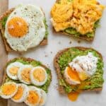 Avocado toast with eggs three ways: scrambled, poached and fried.