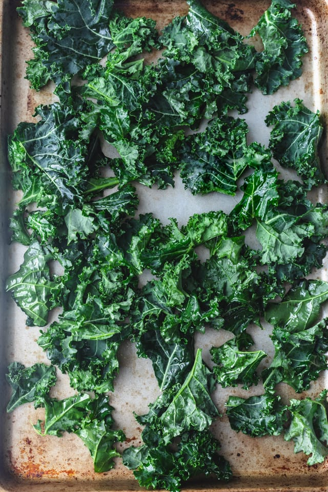 Kale leaves on baking sheet before baking