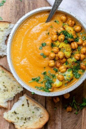 Sweet potato cauliflower soup in a white bowl