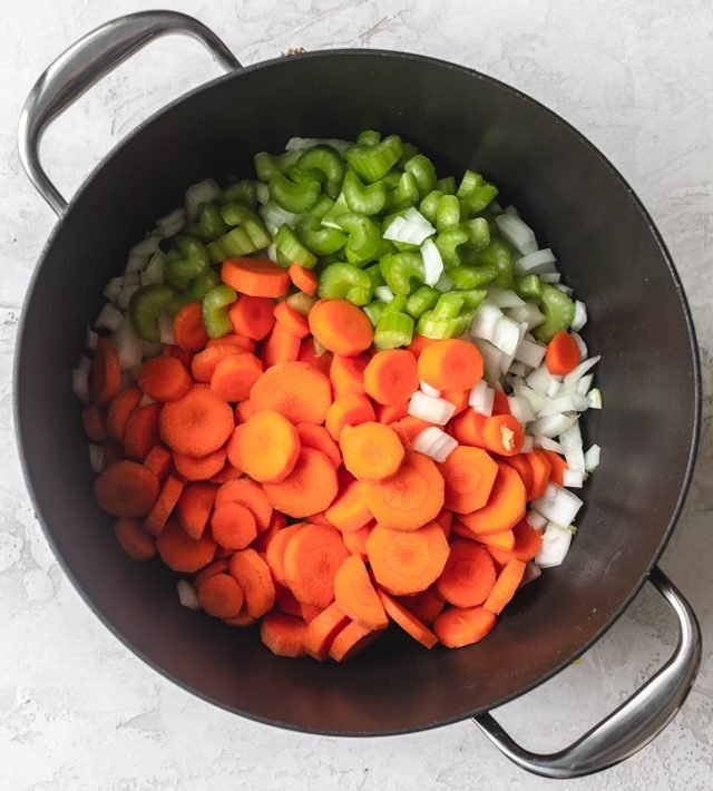 Onions, carrots, celery and garlic in a pot for making Chicken Lemon Rice Soup