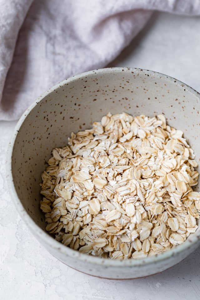 Old fashioned oats in a bowl used to make oatmeal