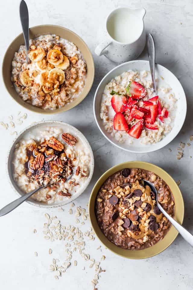 4 bowls of oatmeal, showing the variety of toppings