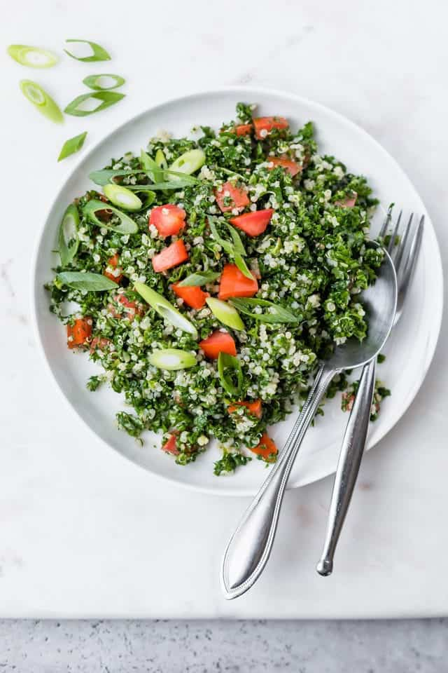 Plate of the of final quinoa tabbouleh recipe garnished with green onions