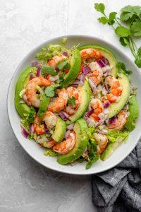 Shrimp avocado salad tossed and ready to serve