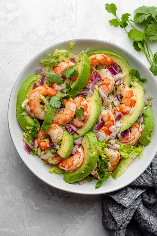 Shrimp avocado salad tossed and ready to serve