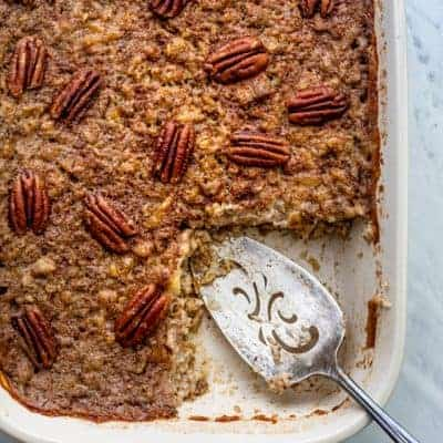Slice cut from baked steel cut oatmeal topped with pecans