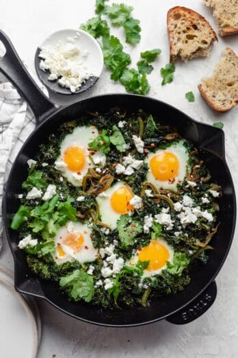 Green Shakshuka cooked in a cast iron skillet