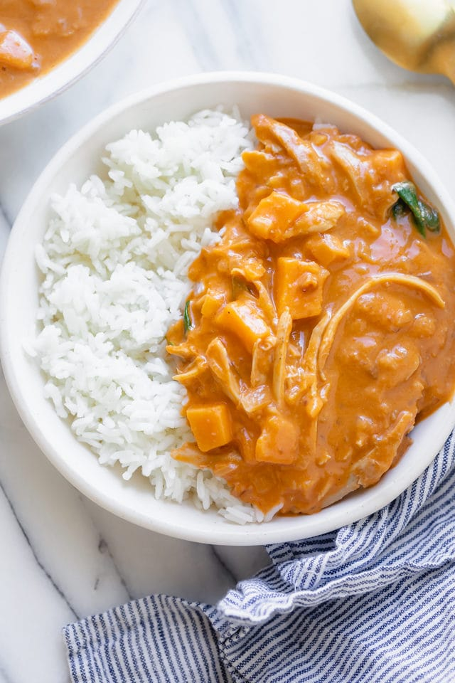 Peanut butter soup served over white rice