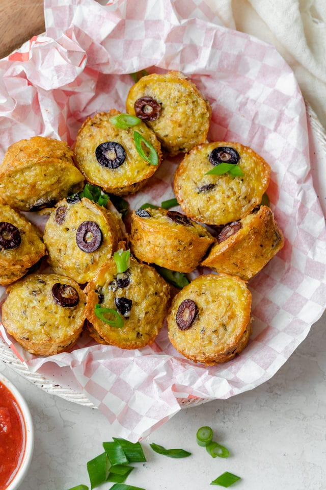 Pizza quinoa bites out of the oven in a serving platter