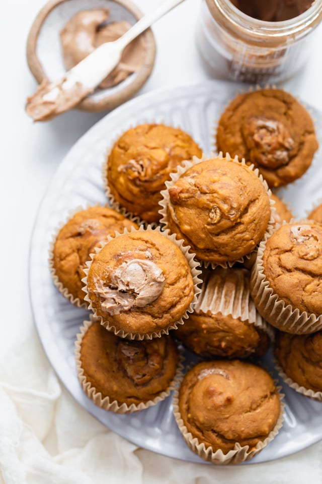Close up shot of the sweet potato muffins with almond butter on the side