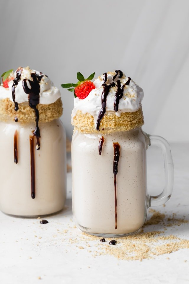 Tahini milkshake frosted glass with chocolate sauce dripping down