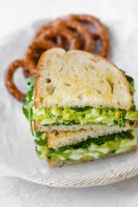 Final avocado egg salad sandwich with pretzels