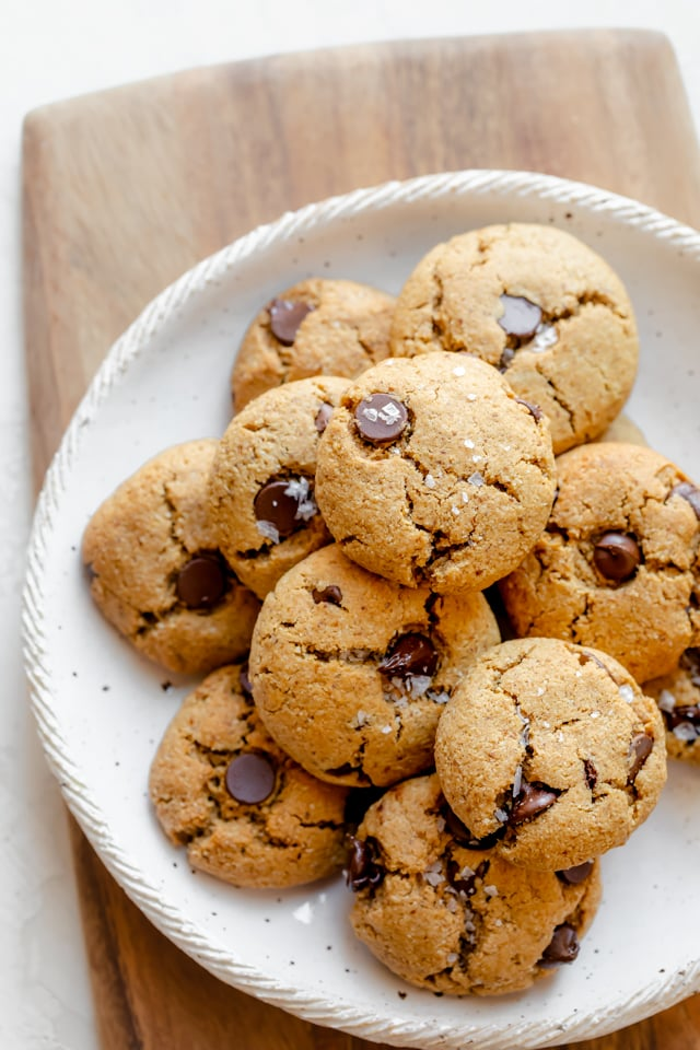 Baked flourless chocolate chip cookies on a large plate
