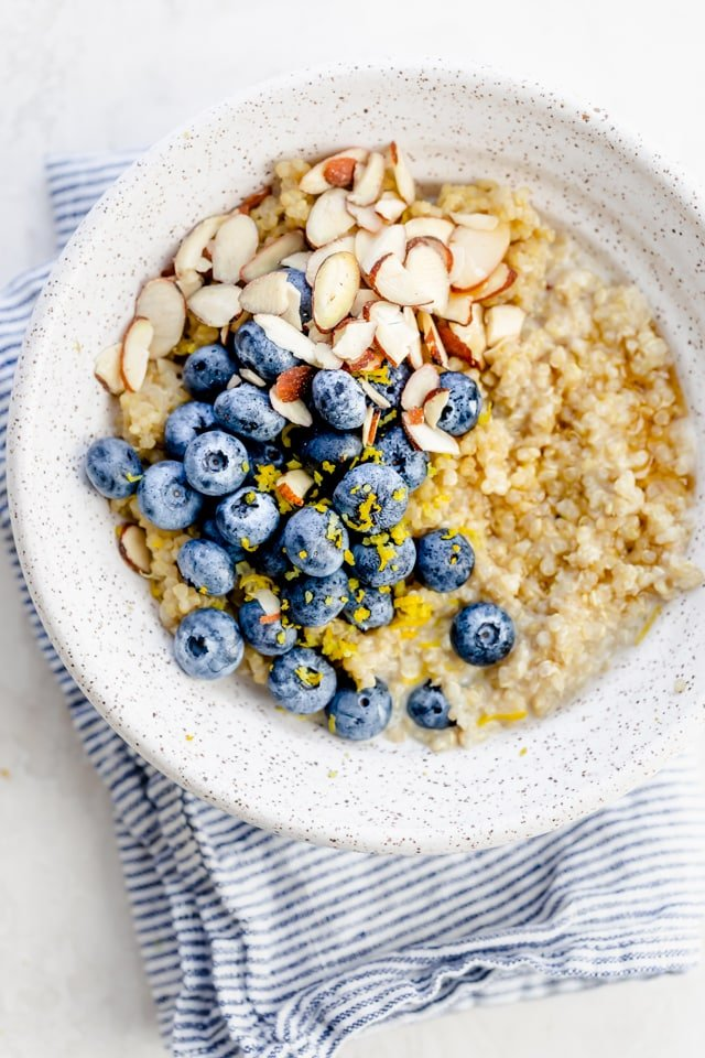 Quinoa breakfast bowl with blueberries, lemon zest and almonds