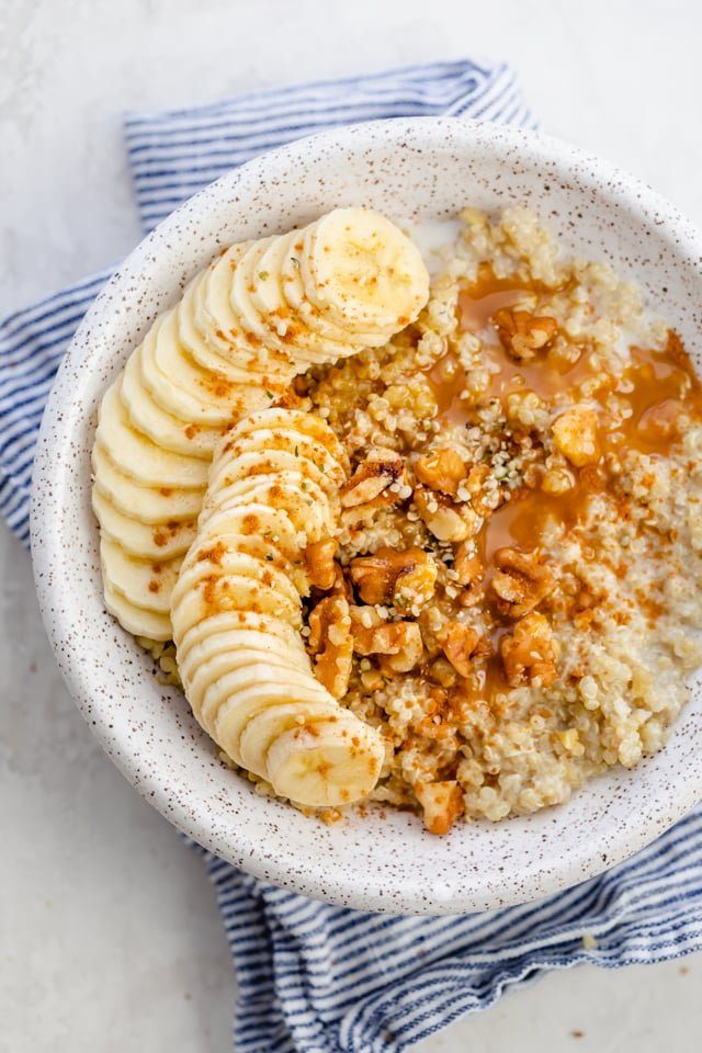 Quinoa breakfast bowl with bananas, walnuts, cinnamon and caramel sauce