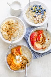 Quinoa oatmeal served with a variety of toppings for breakfast