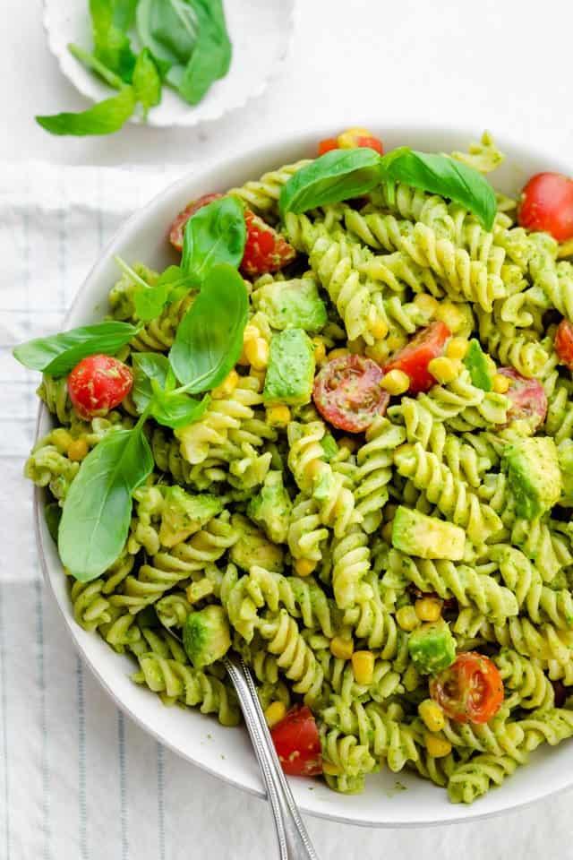 Serving spoon of the avocado pasta salad