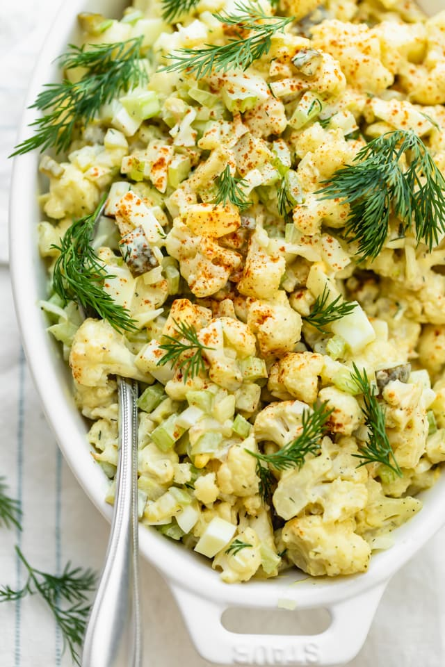 Close up shot of the cauliflower potato salad with a spoon scooping out some