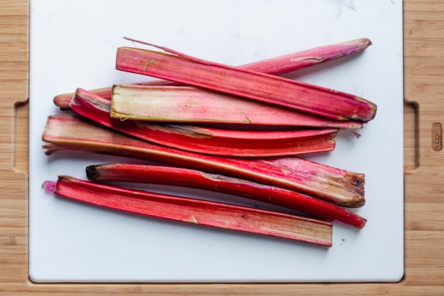 raw rhubarb on a chopping board