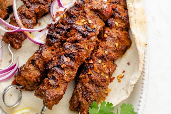Skewers of beef on pita after cooked