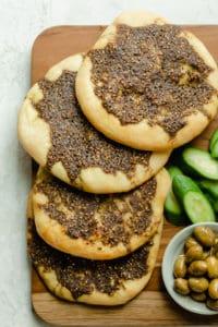 Zaatar Manakish flatbread on a wooden serving board