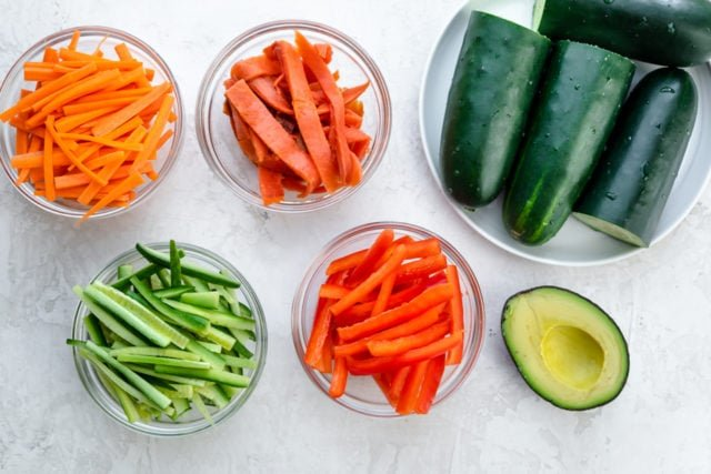 Ingredients to make the recipe: cucumbers, smoked salmon, carrots, red peppers and avocado