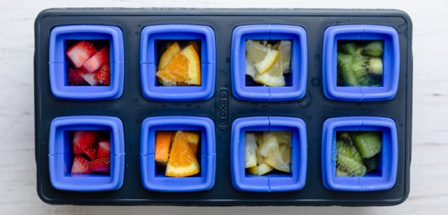 Cut fruit inside of ice cube tray mold before freezing