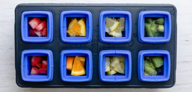 Cut fruit inside of ice cube tray mold before freezing