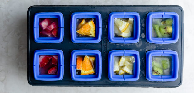Cut fruit inside of ice cube tray mold after freezing