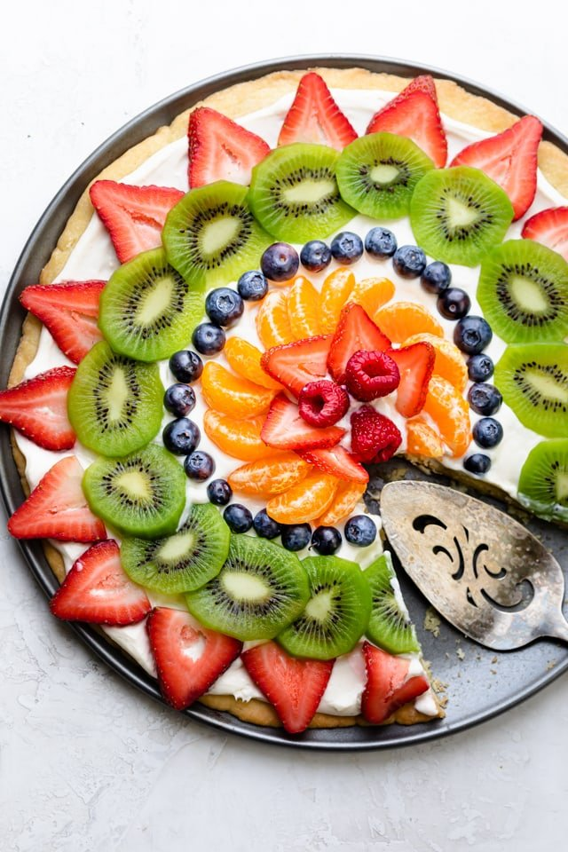 Large circular dessert pizza with slice removed